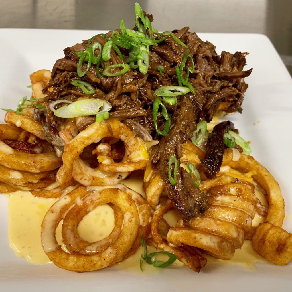 Litte Pub Short Rib Curly Fries  Beer braised, fork shredded, beef short ribs over crispy curly fries smothered in a beer cheese sauce