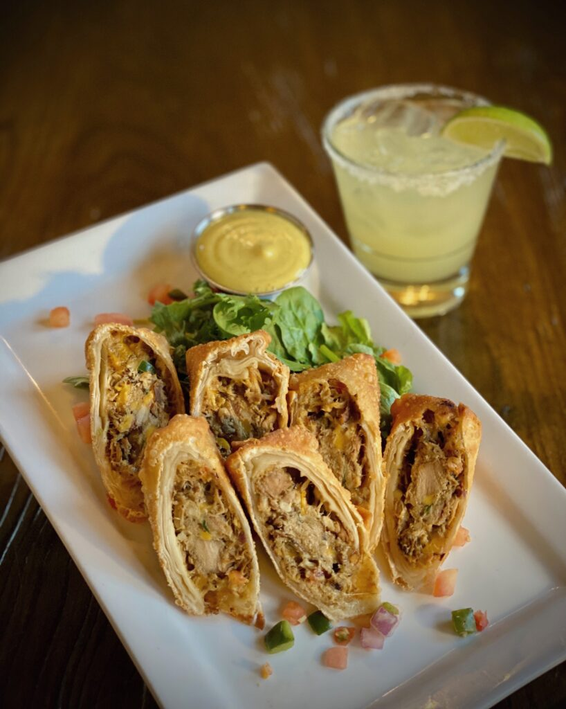 Crispy egg rolls loaded with fork shredded coconut milk simmered Caribbean jerk spiced chicken, cheddar jack cheese, and pico de gallo. Served with a curry honey aioli dip
